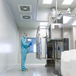 scientist stand near control panel